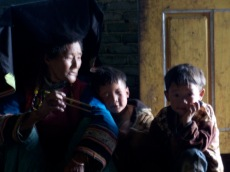 This Yi family lives in a mountain side village.