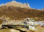 Lung Ta, Tibetan prayer flags, grace the 15,400 ft pass.