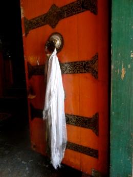 White scarves bring blessings.